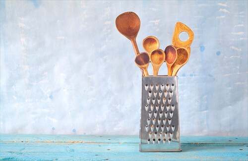 kitchen utensils, wooden spoons and grater, free copy space