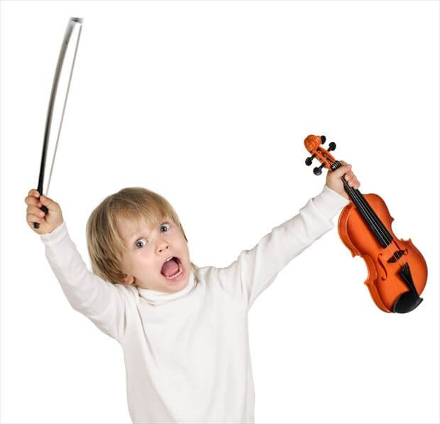 little boy with violin on white background