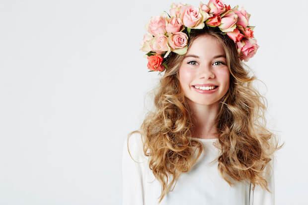 Teenaged flower girl in white
