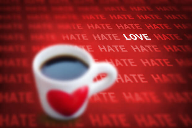 black coffee and heart symbol cup with words hate and love