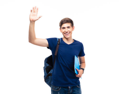 Happy male student showing greeting gesture