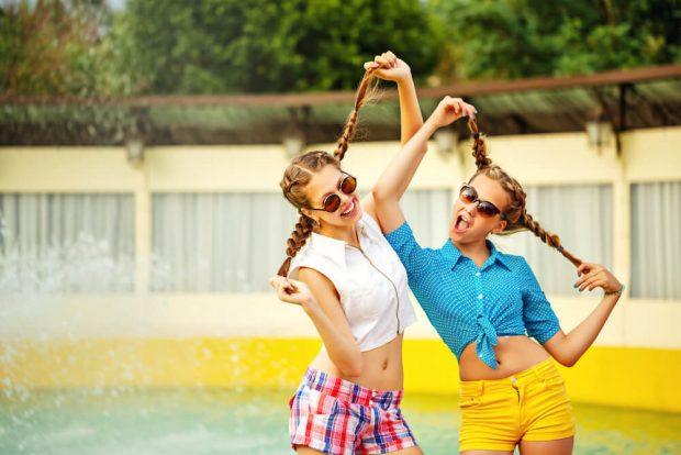 Teen girl in sunglasses having fun.